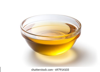 Fresh peanut oil in a glass bowl on white background