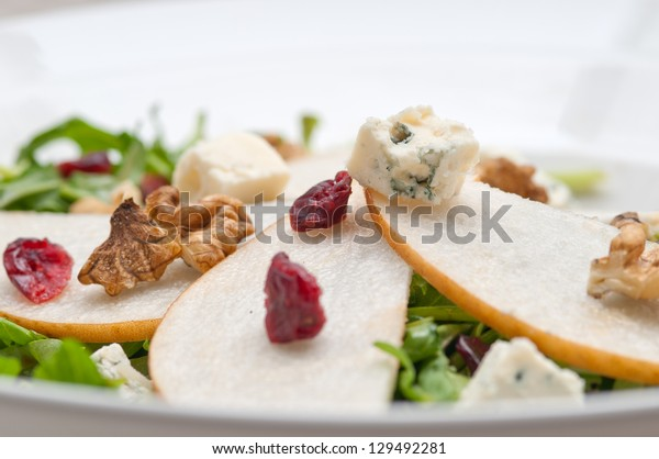 Fresh pears arugula gorgonzola cheese salad with cranberry and walnuts