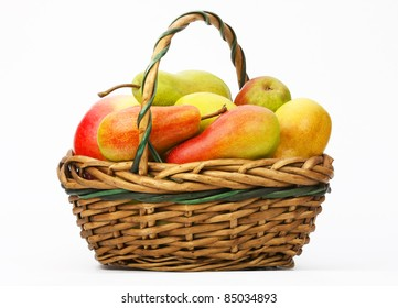 Fresh pears in a basket on a light background