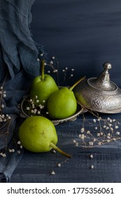 Fresh pears isolated on blue wood