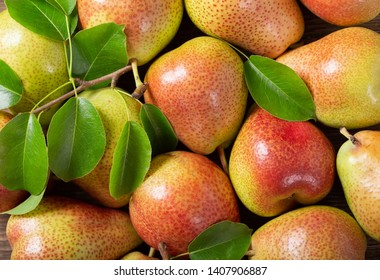 fresh pears with leaves as background, top view