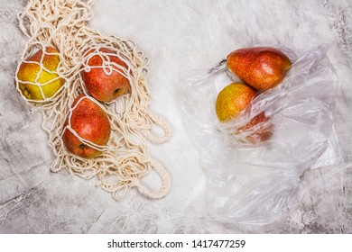 Fresh pears in a mesh bag on stone background with green monstera leaves. Zero waste, less plastic concept. Copy space