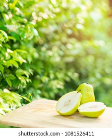 Fresh pears on the brown wooden table in garden,Fresh pears. Green pears in the farm on natural background
