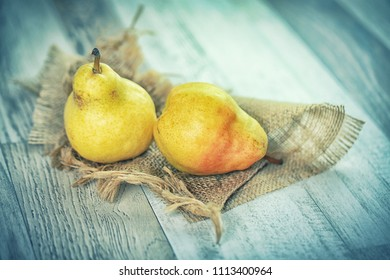 Fresh pears on rustic wooden table