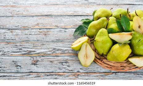 Fresh pears on a white wooden table. Fruits. Free space for text. Top view.