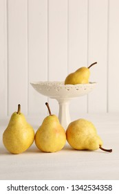 Fresh pears on wooden countertop