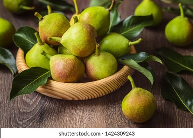 fresh pears in a wooden bowl close-up. background with fresh pears.