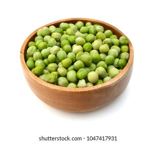 fresh peas isolated in wooden bowl on white background