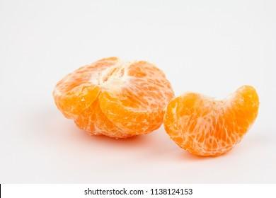 Fresh peeled mandarin orange on white