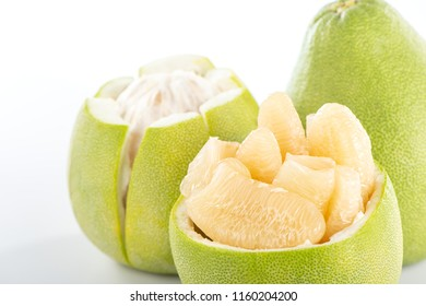 fresh and peeled pomelo(shaddock), grapefruit with slices isolated on white background