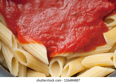 Fresh penne pasta with homemade tomato sauce