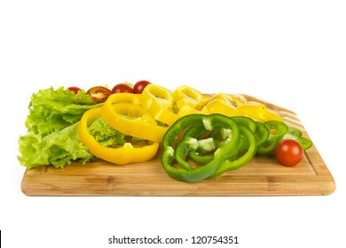 Fresh pepper slices and cherry tomatoes on white background