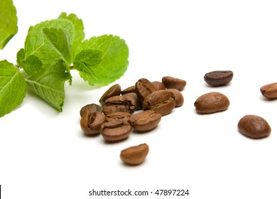 fresh peppermint and coffee beans on white background