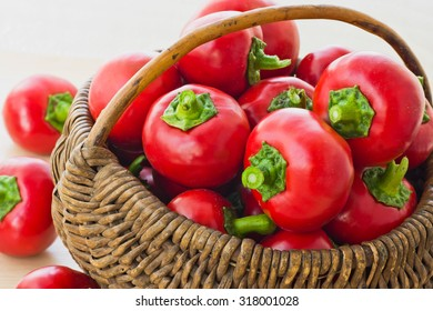 Fresh peppers in old wooden basket
