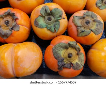 Fresh Persimmon Fruit at the farmers market