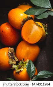Fresh Persimmon or Kaki Fruits Background