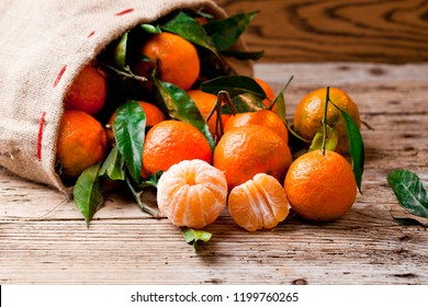 Fresh picked mandarins on wooden background