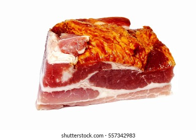 Fresh piece of pork belly meat (bacon steamed) with crust and fat isolated on the white background
