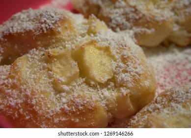 fresh pieces of cake with apple and icing sugar