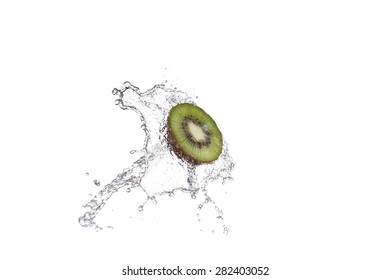 Fresh pieces of kiwi in water splash