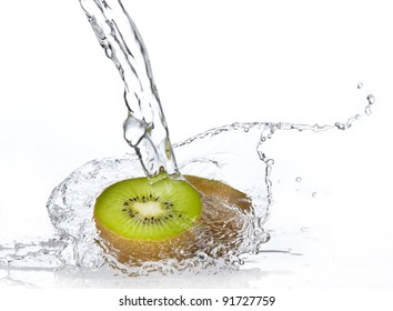 Fresh pieces of kiwi in water splash, isolated on white background