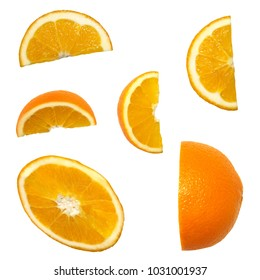 Fresh pieces of orange isolated on white background. Creative minimalistic food concept.