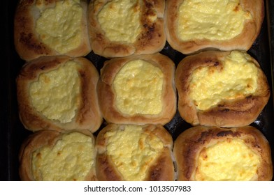 fresh pies with cottage cheese from a yeast dough on a baking sheet, baking with cottage cheese