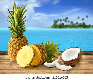 fresh pineapple and coconut in tropical landscape