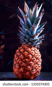 Fresh pineapple, dark wood background, trash toning with color inversion, selective focus