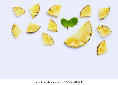 Fresh pineapple slices on white background. Copy space