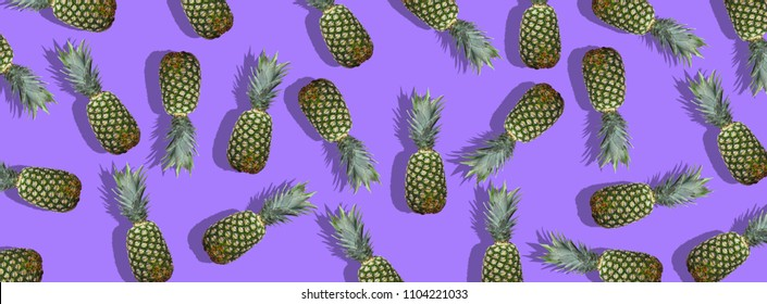 Fresh pineapples on the violet colorfurful background. Creative image for modern designers. Colage