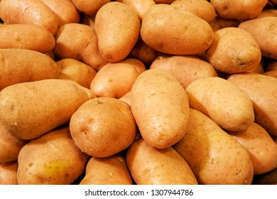 Fresh pink potato on a market. Group of asterix potatoes