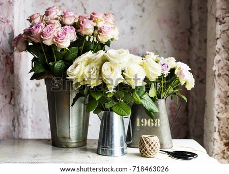 Fresh pink white roses flowers arrangement stock photo edit now fresh pink and white roses flowers arrangement in metal bucket mightylinksfo