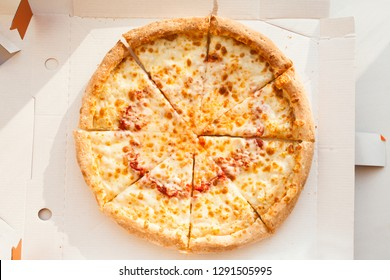 Fresh pizza in box, top view