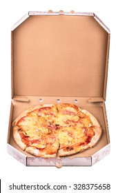 Fresh pizza with sausage lies in an open box isolated on a white background