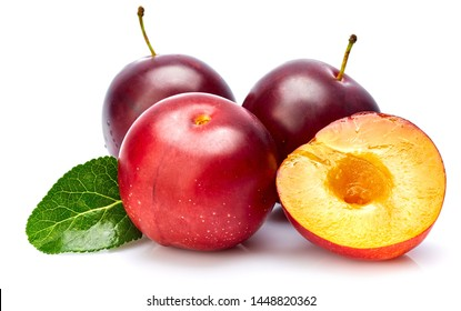 Fresh plum in cut with green leaf. Fruity still life. Healthy food. Isolated on white background.