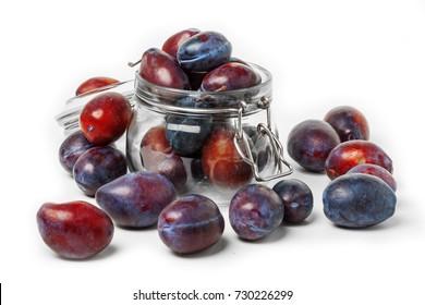 fresh plum isolated on white background and jar
