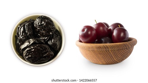 Fresh plums and dried prunes isolated on a white background. Prunes and fresh plum in a bowl on white background. Prunes and plum with copy space for text. Top view. Prune and plum isolated on white.