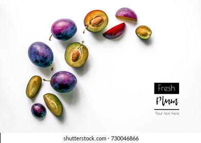 Fresh plums. Food Photo. Creative scheme of whole and sliced â??â??plums on a white background with space for text. View from above. Copy space