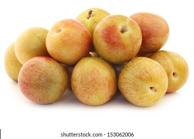 Fresh pluots (Prunus salicina x armeniaca) on a white background (A pluot is a cross between an apricot and a plum)