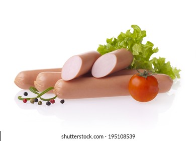 Fresh polish hot dog sausages, lettuce and tomatoes. Meat composition taken on white background with reflection.