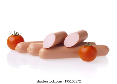 Fresh polish hot dog sausages and tomatoes. Meat composition taken on white background with reflection.