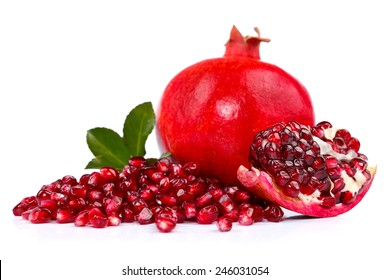 Fresh pomegranate with seeds in the front