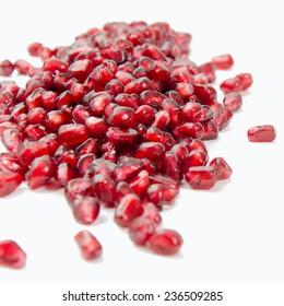 Fresh pomegranate seeds isolated on white