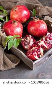 Fresh pomegranates in wooden box