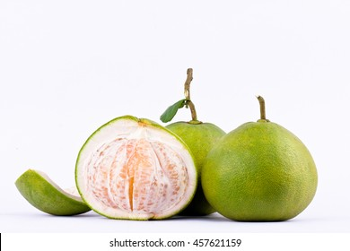 fresh pomelos peeled  and green pomelos on white background healthy fruit food isolated