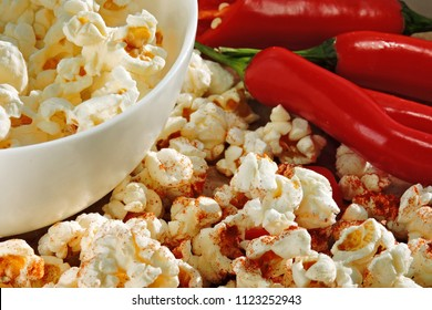 Fresh popcorn with chili pepper. Spicy hot popcorn.