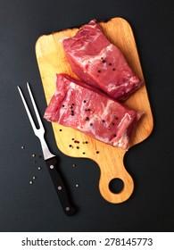 fresh pork meat on a dark background