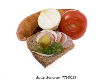Fresh pork sausage with bread, cucumber, onion,tomato