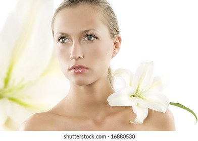 fresh portrait of a young and beautiful woman with a white lily